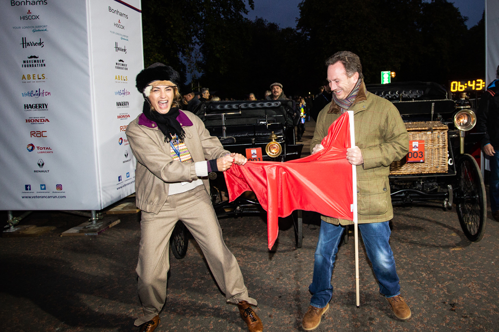 Yasmin Le Bon and Christian Horner ripping the cerimonial Red Flag before the start of the 2018 Bonhams London to Brighton Veteran Car Run